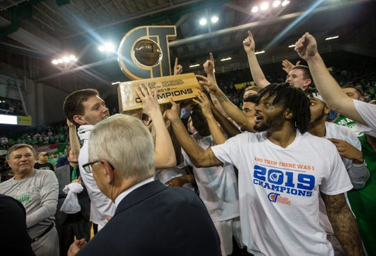 Marshall players celebrate a win over Green Bay in the championship game of the CollegeInsider.com Tournament on Thursday, April 4, 2019, in Huntington, W.Va.  (Sholten Singer/The Herald-Dispatch via AP)