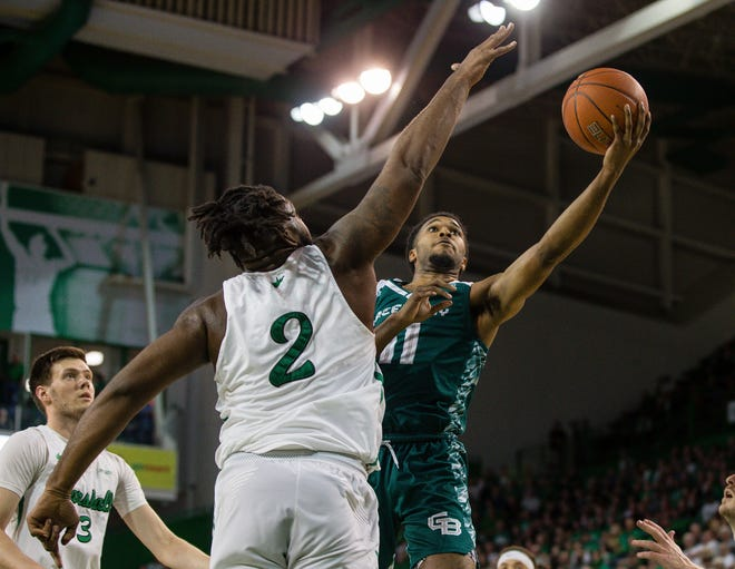UWGB senior guard JayQuan McCloud, pictured against Marshall last season, scored a game-high 30 points in a loss to Youngstown State University on Saturday.