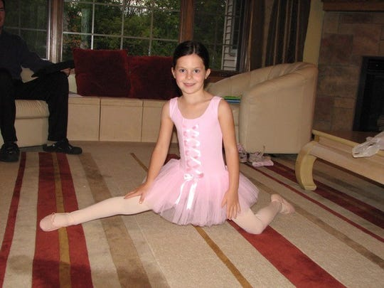 Laura Sullivan, age 5, attempting the splits. Looking back at family photos can be a source of joy.
