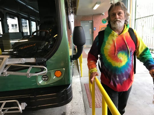 Henry Davis Jr. of Greenville waits Friday, April 5, 2019, at the GreenLink transit station downtown for a bus to take him to Walmart. Davis, who works at a couple downtown restaurants and is currently homeless, said he could find affordable housing outside the city center if buses ran later into the night.