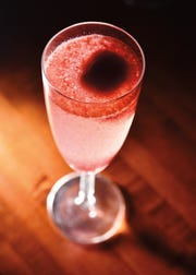 The Sorbagne, a champange flute of bubbles with a scoop of housemade sorbet from Encore.