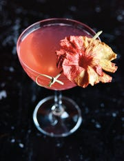 The Ruby Belle from Encore with Belle Isle Ruby Red, Cointreau, Pama, lime juice with a splash of soda.