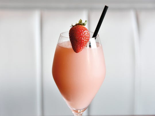 The Frose´ with Tito's Handmade Vodka, sparkling Rose´, and strawberry simple syryp.