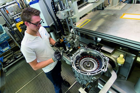 A technician in Germany works on a prototype of ZF's enhanced 8-speed automatic transmission. The auto supplier, which received an order from BMW worth billions for this product, will start production at its Saarbrücken plant in 2022. Production in South Carolina for BMW's Spartanburg plant will follow, the ZF announced Friday, April 5, 2019.