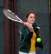 CMR's Madison George follows through on a backhand return shot in doubles play during Thursday's tennis dual against Cut Bank at Meadow Lark Country Club.