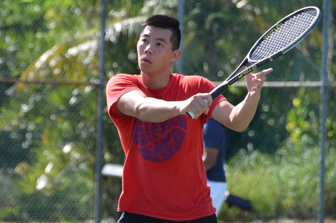 Geo Wu prepares to hit a backhand during his Men's 5.0 finals match at the 47th Annual Chamorro Open.