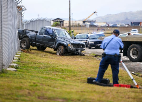 Guam Police Department's Highway Patrol Division officers conduct an investigation of an auto-ran-off roadway crash, involving a 1991 Toyota Hilux pickup, along East Sunset Boulevard in Tiyan on Friday, April 5, 2019. While enroute to Naval Hospital Guam, CPR was administered to the 58-year-old male driver who was later pronounced deceased by attending hospital physicians, GPD spokesman Sgt. Paul Tapao said. The section of the roadway was closed off to traffic in both directions, by GPD and the Guam Airport Police, as officers conducted their investigation.