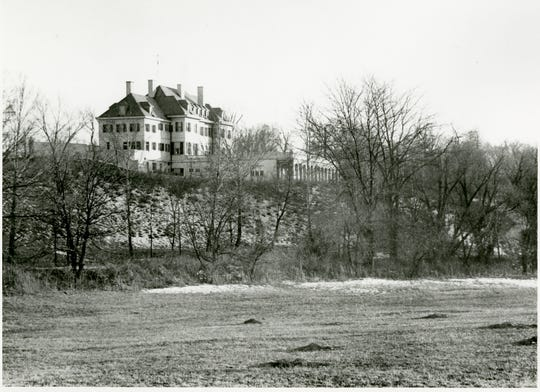The view from the back of Oldfields-Lilly House Estate, shown here around 1930, originally was of a floodplain for grain, which was low enough to allow the family glimpses of the White River. The swath of trees Newfields is removing will restore some of that view.