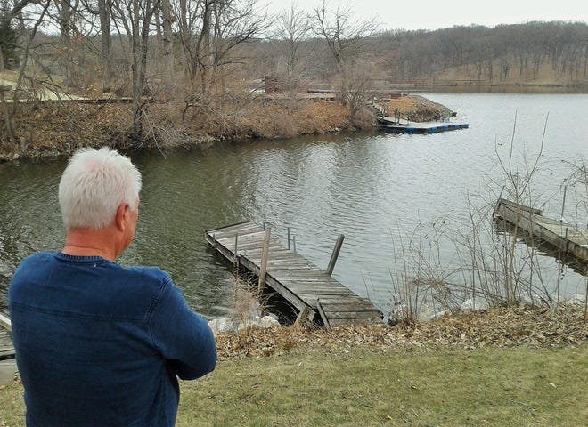 Mark Ramsey ponders the small cove at Lake Macbride where nearly 20 years ago he discovered the long-missing Chevy Lumina driven by Bob Fletcher. The vehicle rolled down between these two docks into the water and left no tracks to alert searchers. If the Iowa DNR had not drained the lake for regular maintenance, Fletcher's body and the car may never have been found.