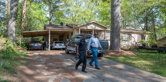 Jackson Police Department Crime Scene Investigator Andrew Harris, left, and Willie Sanders, investigator with the Hinds County District Attorney's Office, leave the Jackson home of Shelia Ragland on Wednesday, April 3, 2019, after taking photos and talking with her. It was at Ragland's home on Feb. 14, 2019, where JPD responded to a 911 call to assist when her son, Mario Clark, was having a psychotic episode. Clark, who had been diagnosed as having paranoid schizophrenia, later died. A supervisor and three JPD officers have been fired. The death has been ruled a homicide.