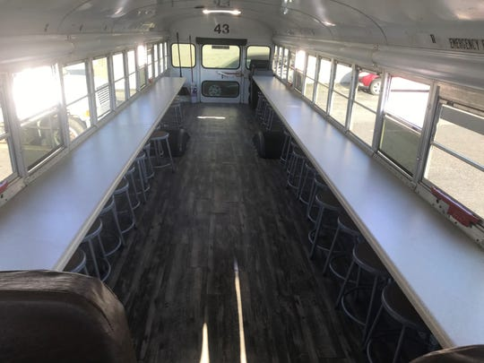 The refurbished bus allows children to get on the bus for lunch during the summer months when school is out.