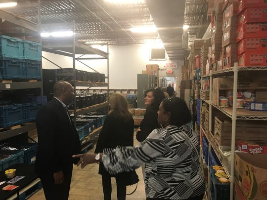 RIFA donors passing through the warehouse talk with RIFA board member and Jackson-Madison County Schools Superintendent Eric Jones on the way to the soup kitchen.