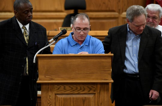 Bobby Reynolds reads a three-page letter thanking those who helped him and 13 other Madison County Jail inmates to receive certificates from the Life's Healing Choices Program, Friday, April 5. The 8-week program is sponsored by Celebrate Recovery Ministry.