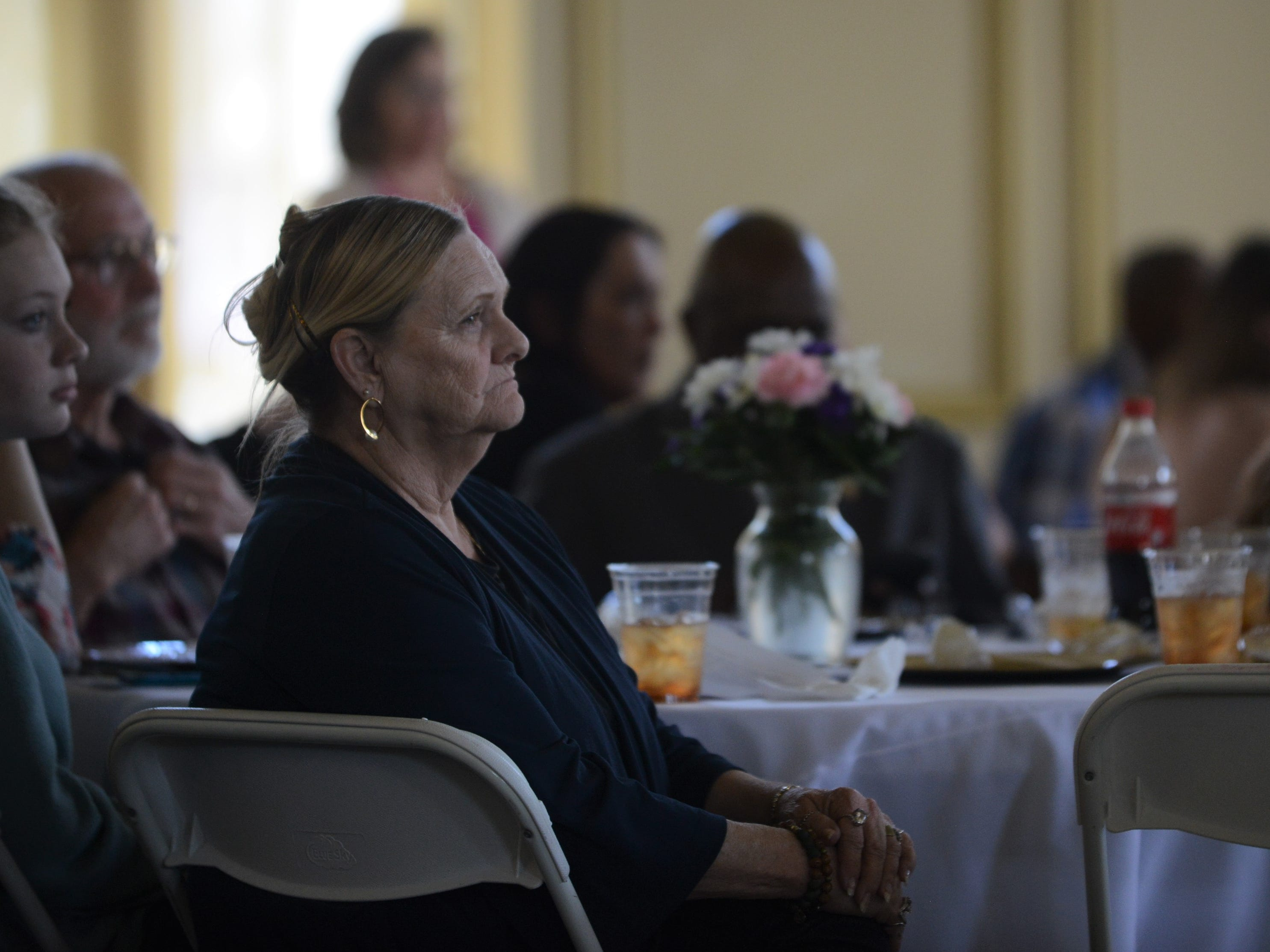 Thelma Knight tears up as she watches the testimonies of the Jackson Recovery Court graduates at the Jackson Recovery Court graduation luncheon at the New Southern Hotel on Wednesday, April 3. Her son, Tony Knight, and daughter-in-law, Deanna Knight, graduated from the program Wednesday.