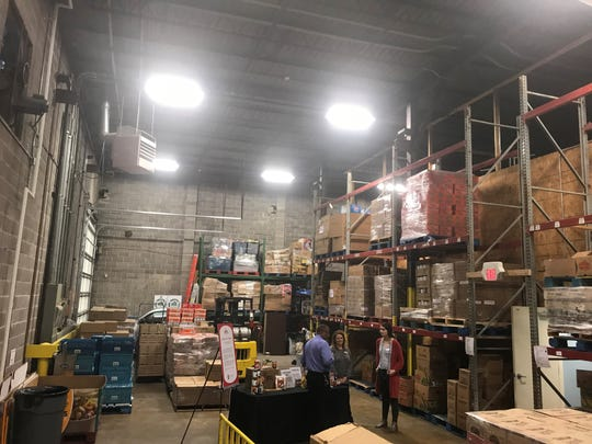 Pallets of food are stacked high in the warehouse to plenty are available for needy people in Jackson who need food.