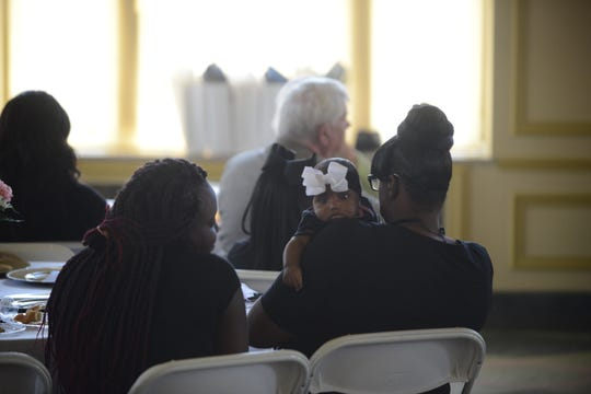 Jackson Recovery Court graduate Nicole Carney holds her granddaughter Malaysia at the Jackson Recovery Court graduation luncheon at the New Southern Hotel on Wednesday, April 3.