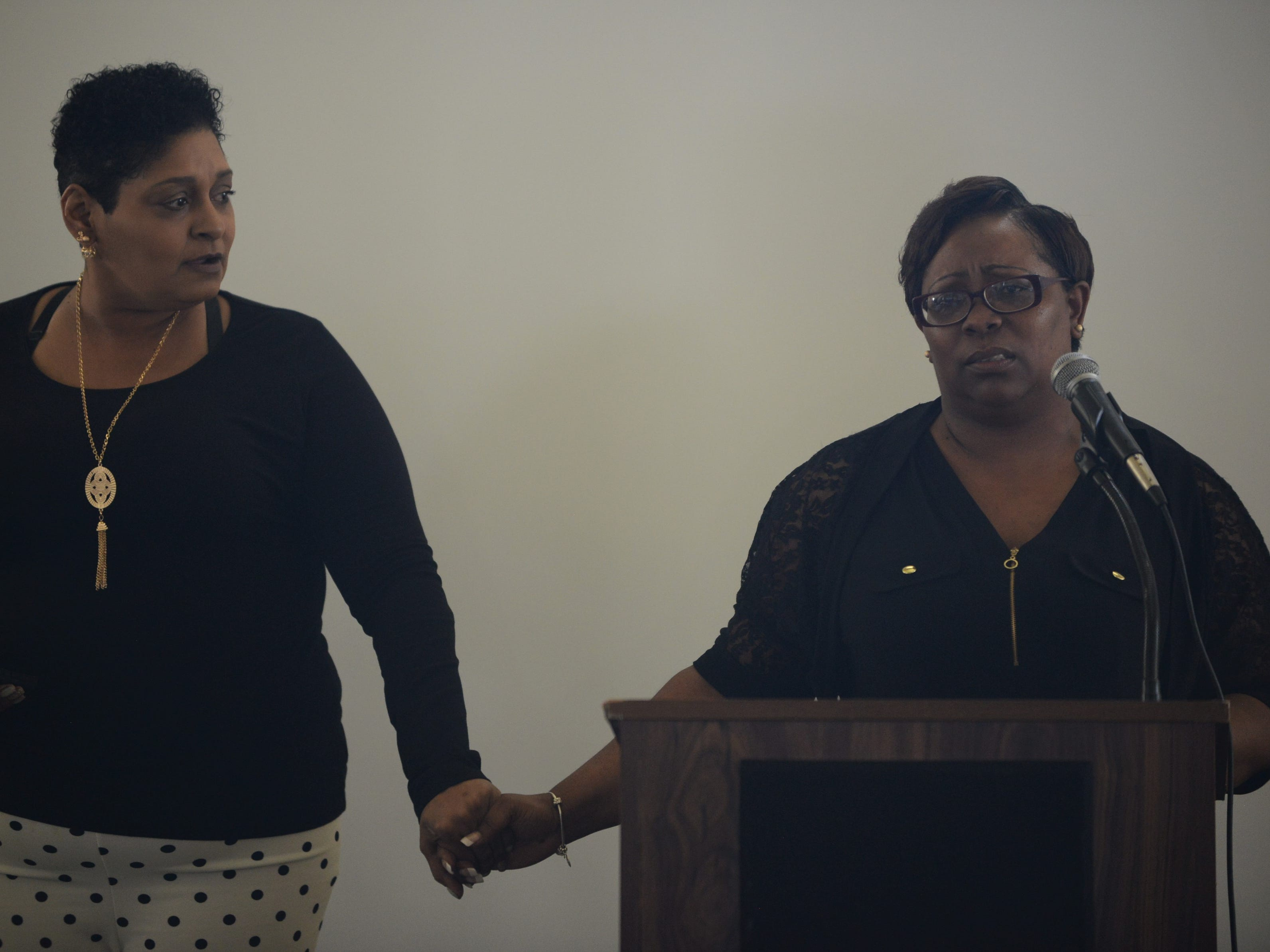 Gwen Woods, Jackson Recovery Court Graduate, is comforted by another program participant as she speaks to the crowd at the Jackson Recovery Court graduation luncheon at the New Southern Hotel on Wednesday, April 3.