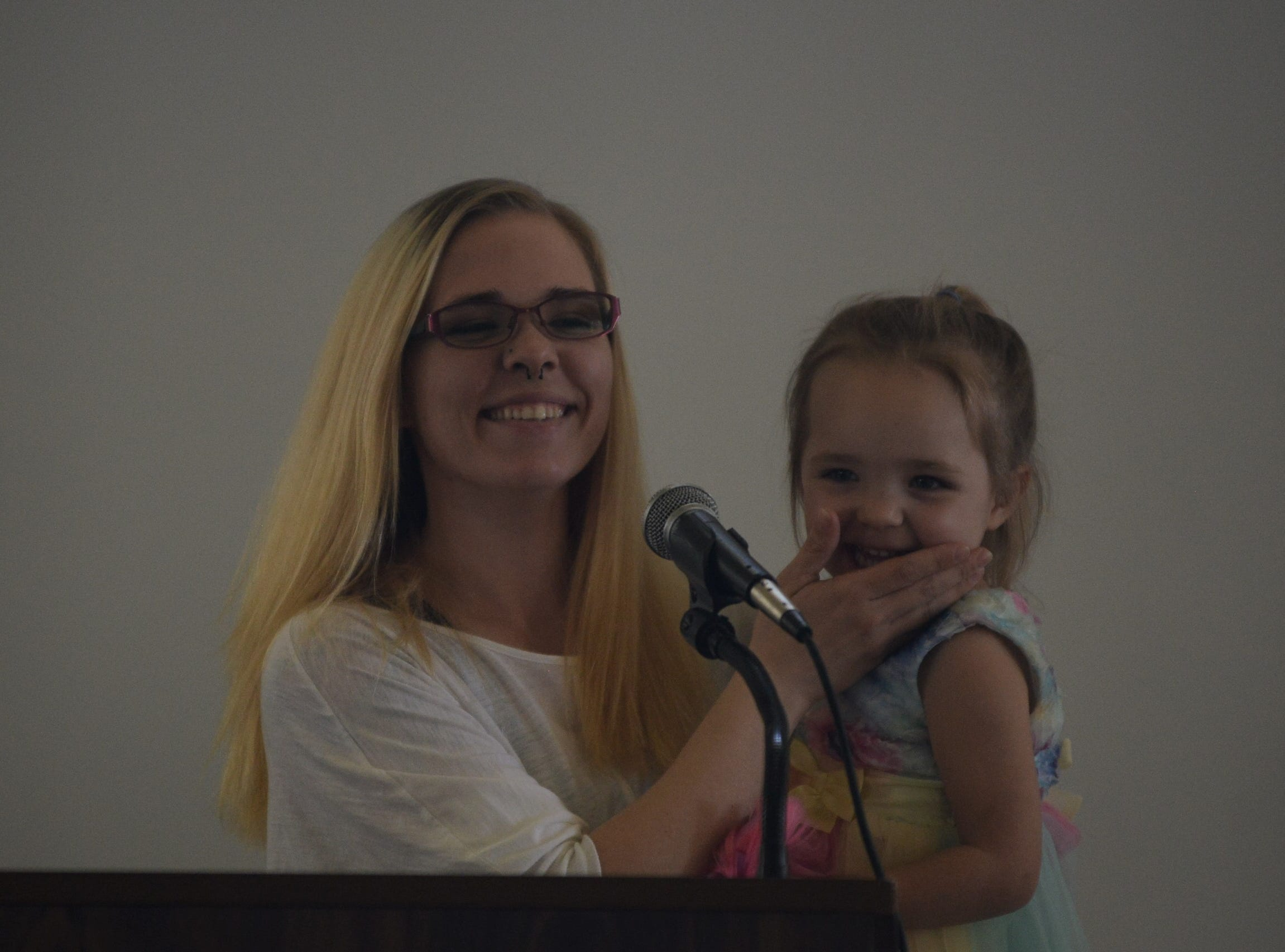 Jackson Recovery Court program participant Heather Richardson holds her daughter Elena as she addresses the crowd at the Jackson Recovery Court graduation luncheon at the New Southern Hotel on Wednesday, April 3.