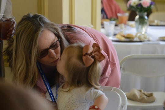 """Dianne Sherrod, Project Lifeline Coordinator, stops to kiss Faith Osborne at the Jackson Recovery Court graduation luncheon at the New Southern Hotel on Wednesday, April 3. Osborne's mother was a house monitor at the care center and serves as a mentor to those in Recovery Court. Sherrod says she is one of their """"success stories."""""""