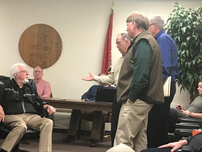 CJC coordinator Thomas Rudder, along with Madison County Sheriff John Mehr and MCSO budget manager Barry Smith, discuss finances with Madison County Commission Chairman Gary Deaton during the financial management committee meeting on April 2, 2019.