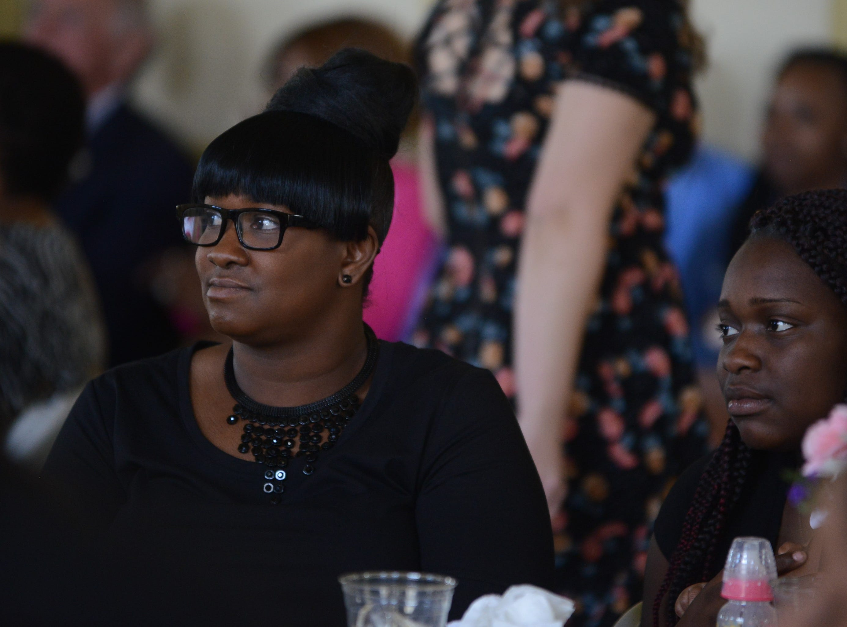 Recovery Court graduate Nicole Carney watches others give their testimonies while surrounded by her family at the Jackson Recovery Court graduation luncheon at the New Southern Hotel on Wednesday, April 3.