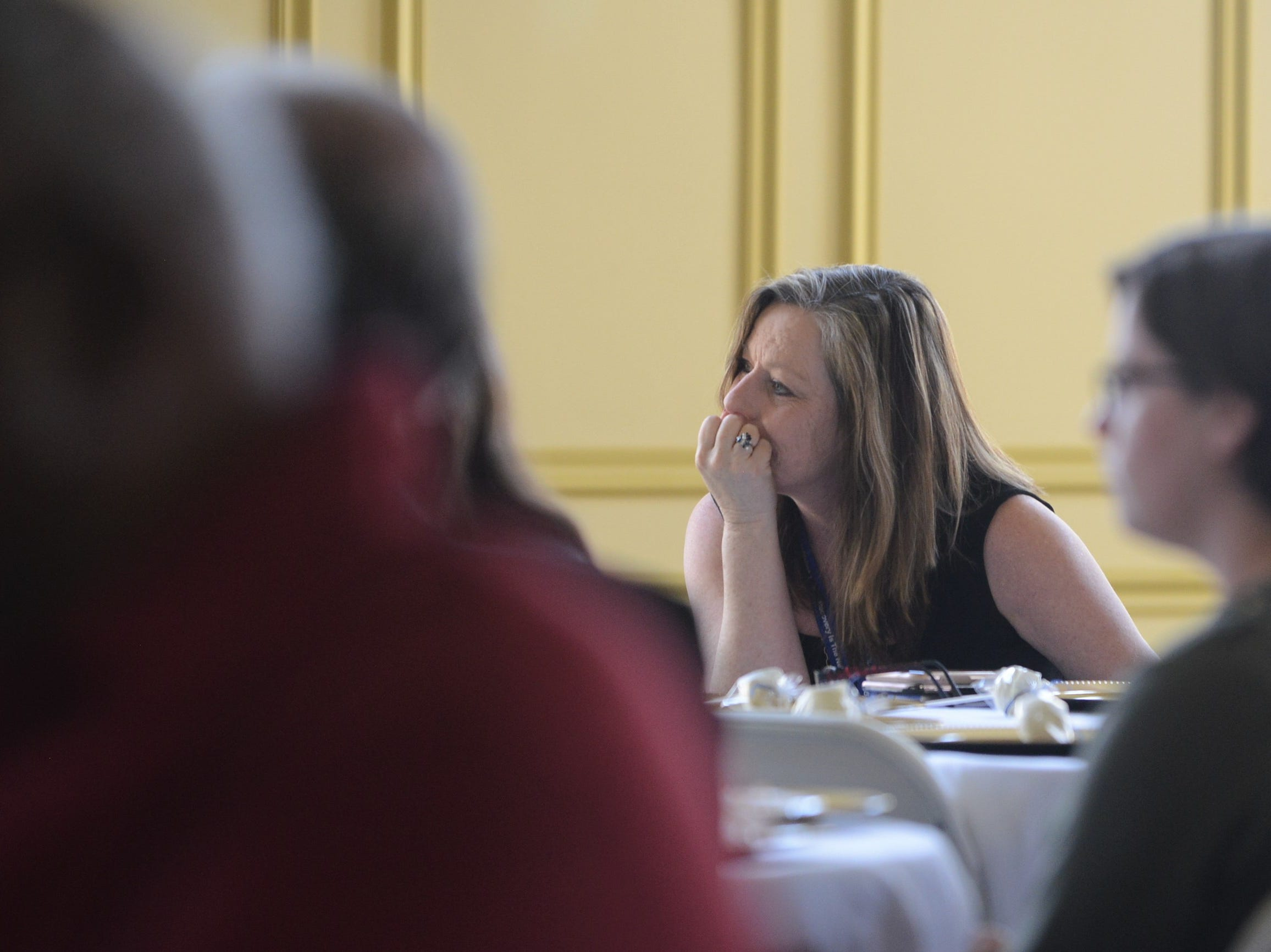 Project Lifeline Coordinator Dianne Sherrod listens to graduate testimonies at the Jackson Recovery Court graduation luncheon at the New Southern Hotel on Wednesday, April 3.