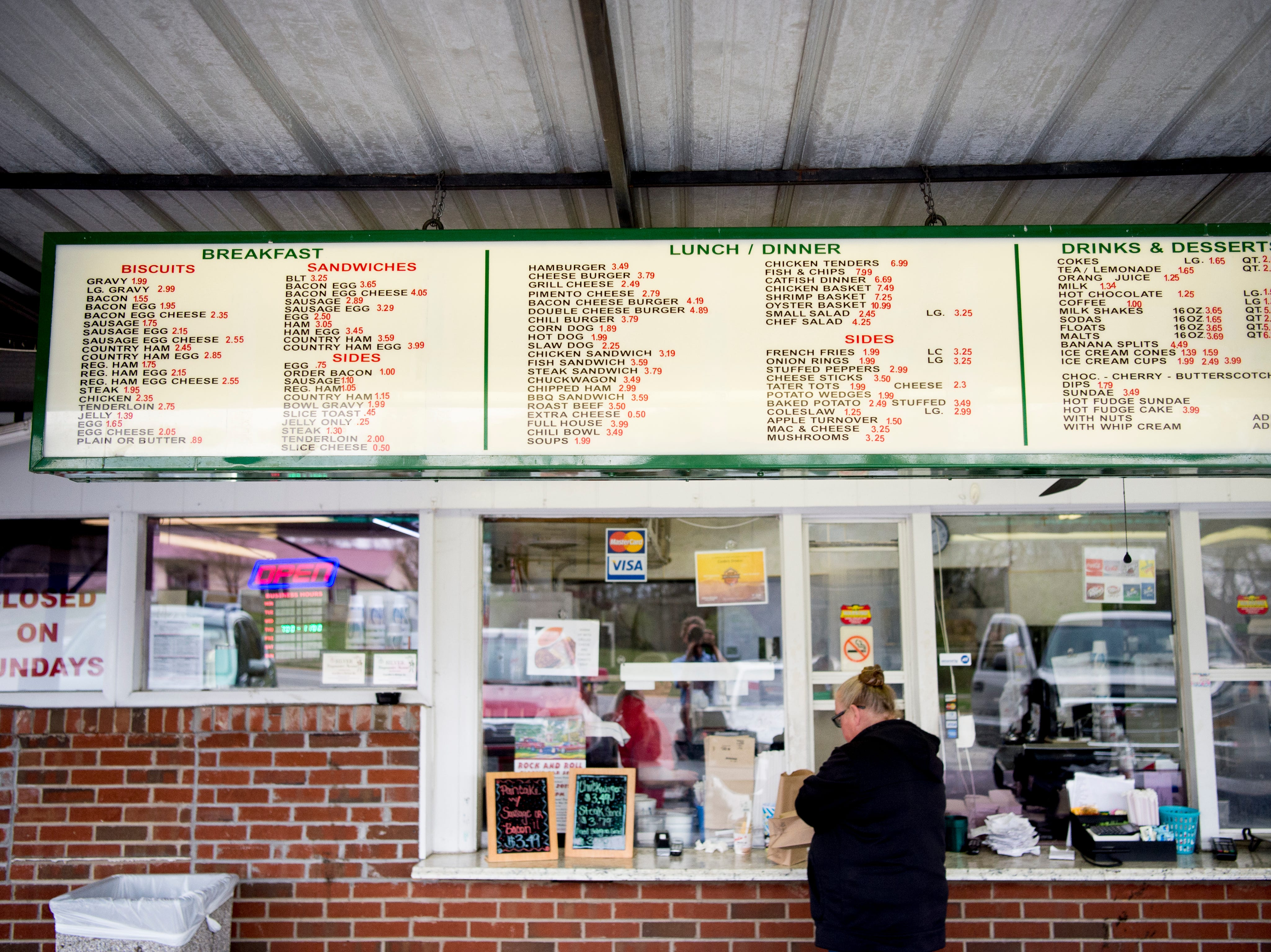 The menu above the main window at Cardin's Drive-In on Asheville Highway in Knoxville, Tennessee on Friday, April 5, 2019. The popular drive-in is celebrating 60 years of business this Saturday with sixty cent ice cream cones.