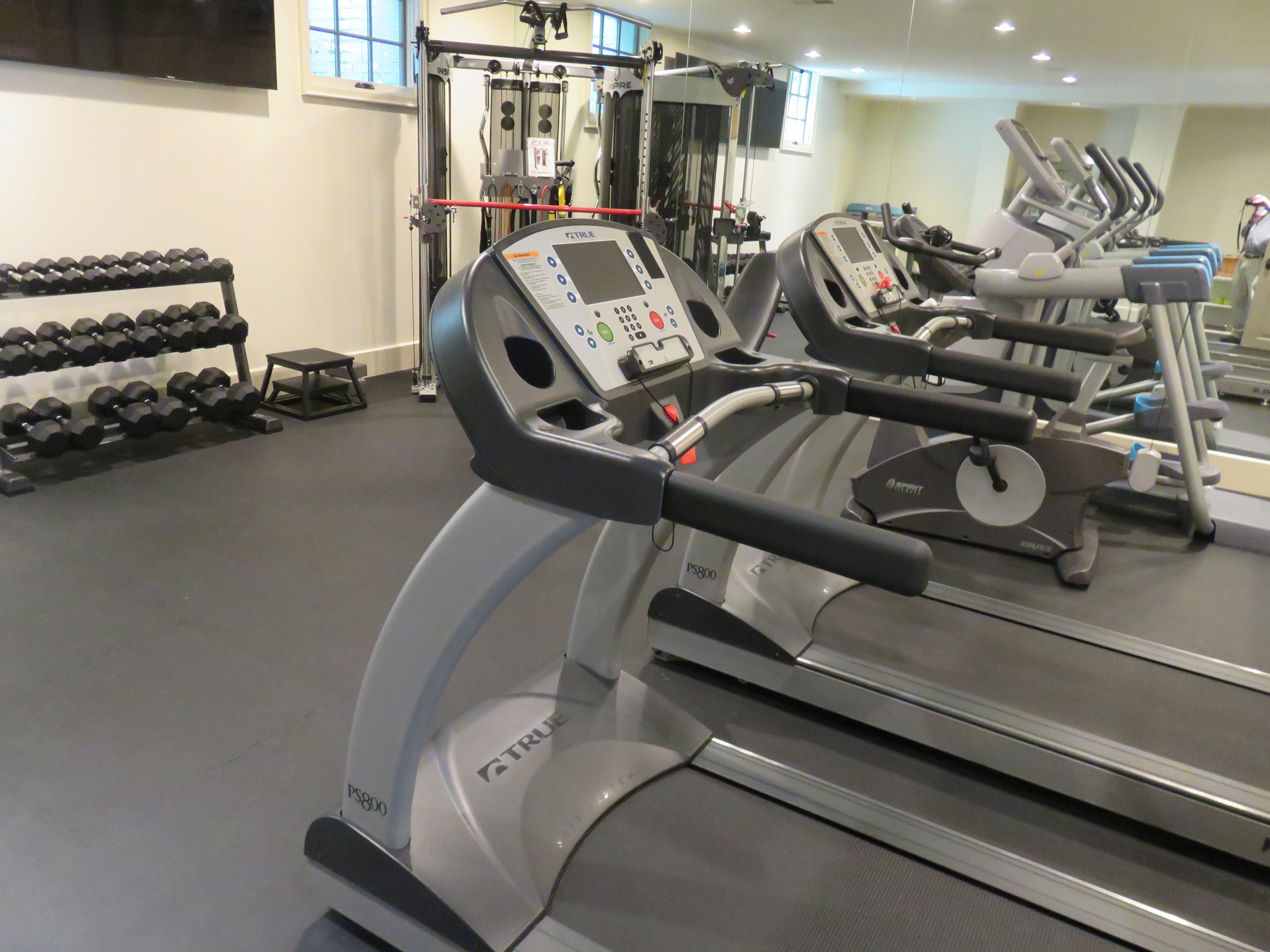 The lower level of the Magnolia Bluff home features a gym.