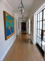 The gallery hallway leads to the veranda.