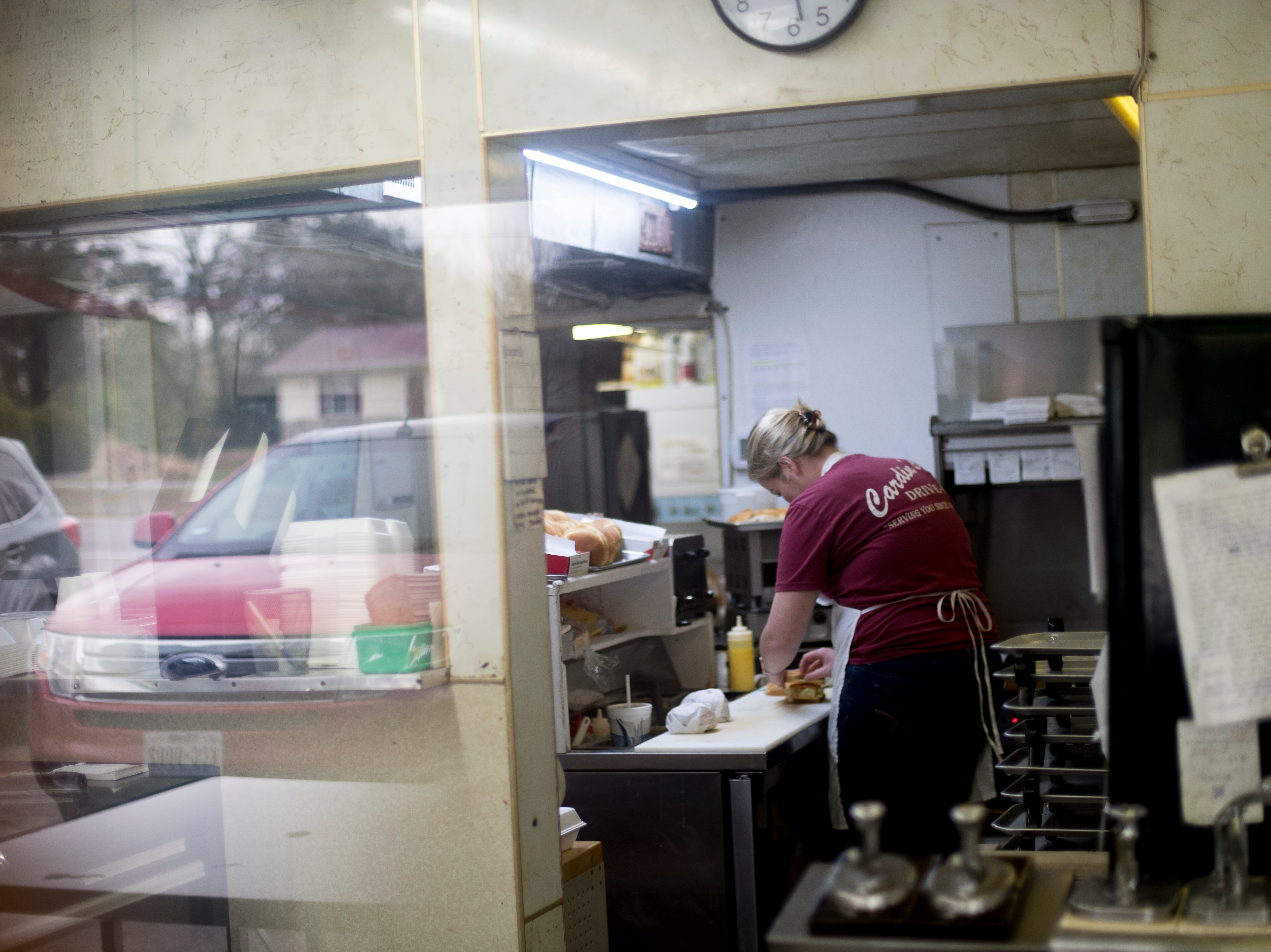 Cooks prepare meals in the kitchen at Cardin's Drive-In on Asheville Highway in Knoxville, Tennessee on Friday, April 5, 2019. The popular drive-in is celebrating 60 years of business this Saturday with sixty cent ice cream cones.