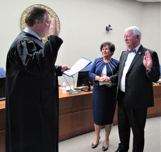 Town judge Keith Alley administers the oath of office Aug. 23, 2018, to new Mayor Ron Williams as TC Williams holds the family Bible. Since then, Williams has been driving the town's agenda to increase revenue.
