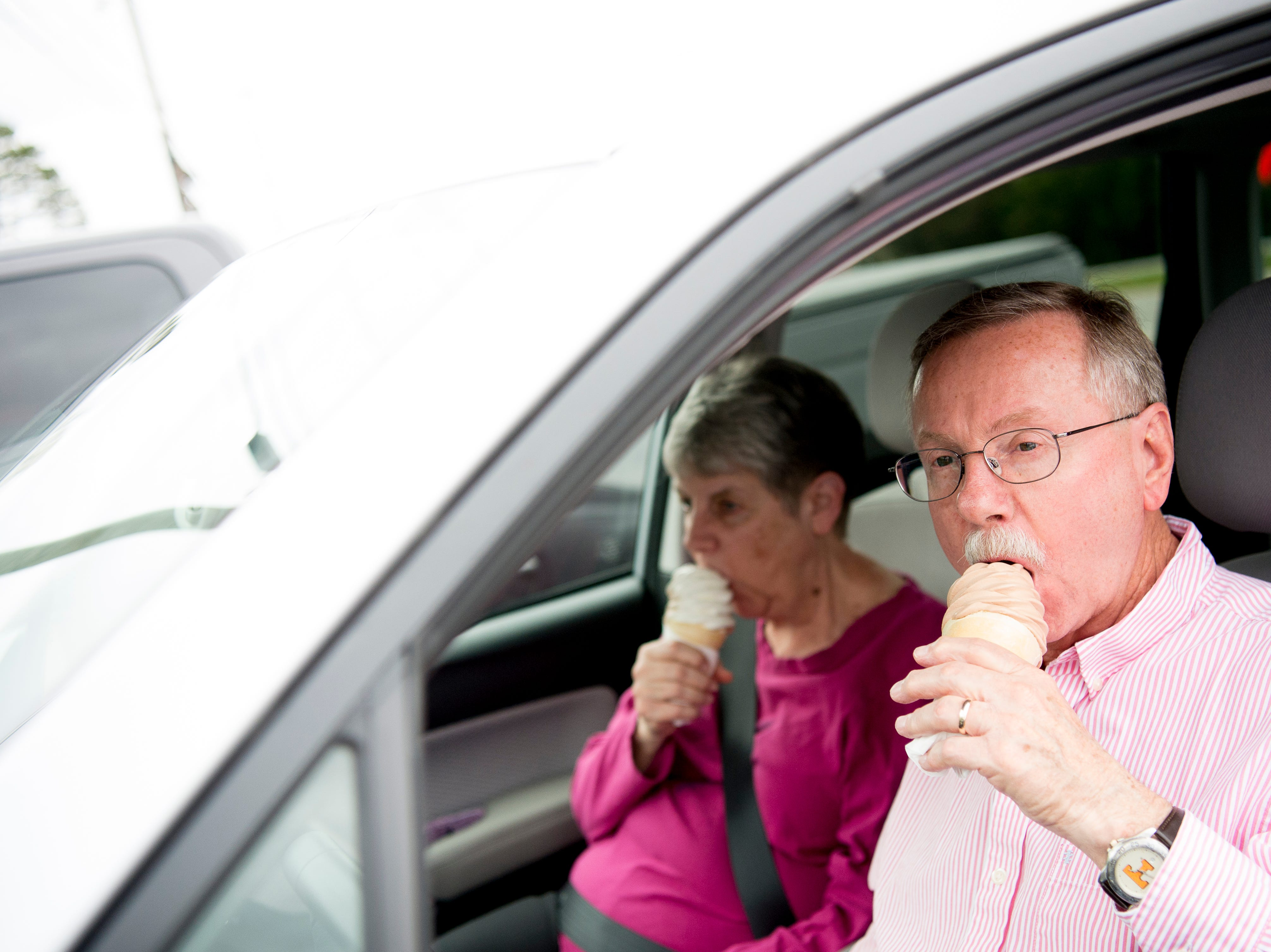 Ray and Alice Petty, from Knoxville, enjoy an ice cream cone at Cardin's Drive-In on Asheville Highway in Knoxville, Tennessee on Friday, April 5, 2019. They said they will stop at Cardin's occasionally for an ice cream when passing by, and look forward to trying the burgers and fries at their next visit. The popular drive-in is celebrating 60 years of business this Saturday with sixty cent ice cream cones.