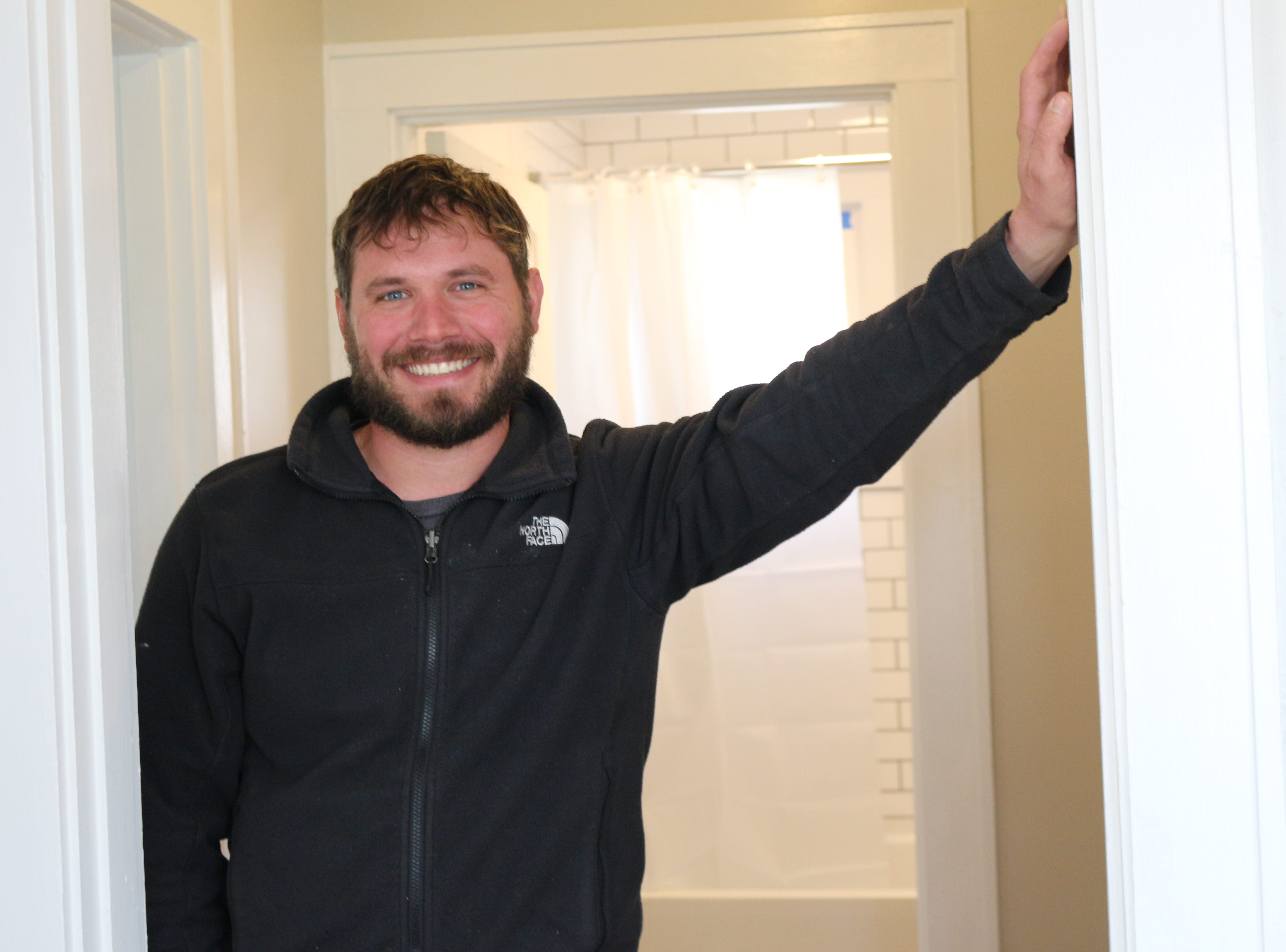 New to Knoxville, David Brimer stands in the home he's renovating for him and his wife on Moody Avenue. April 2019