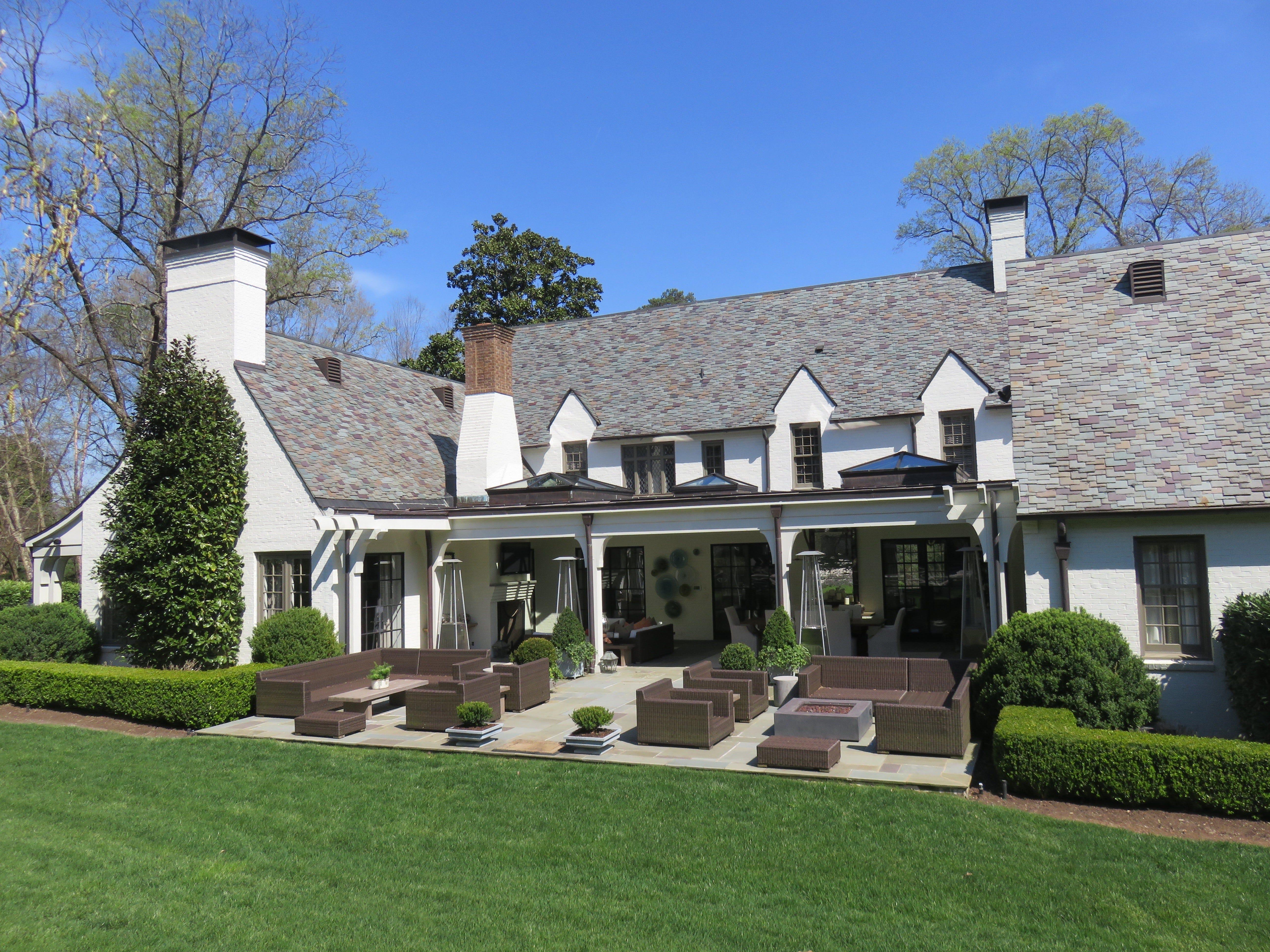 Back of Bluff Drive home features an expansive veranda/terrace.