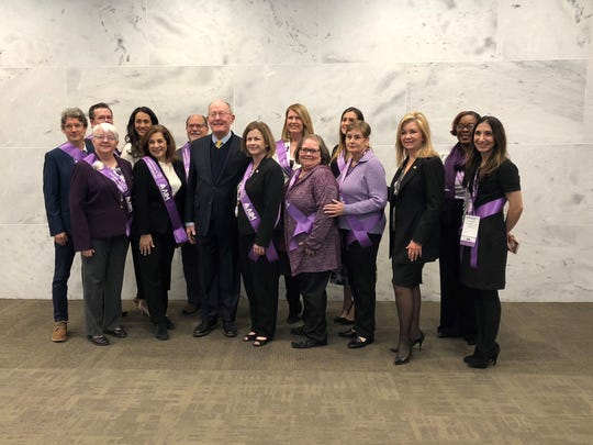 Alzheimer Ambassadors pose for a photo with Sens. Lamar Alexander and Marsha Blackburn. March 2019