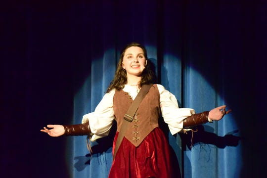 """The Minstrel (Mary Beth Seibel) tells the tale of how Princess Winnifred came to win the hand of Prince Dauntless in Karns High School's musical production of """"Once Upon a Mattress"""". April 2019"""