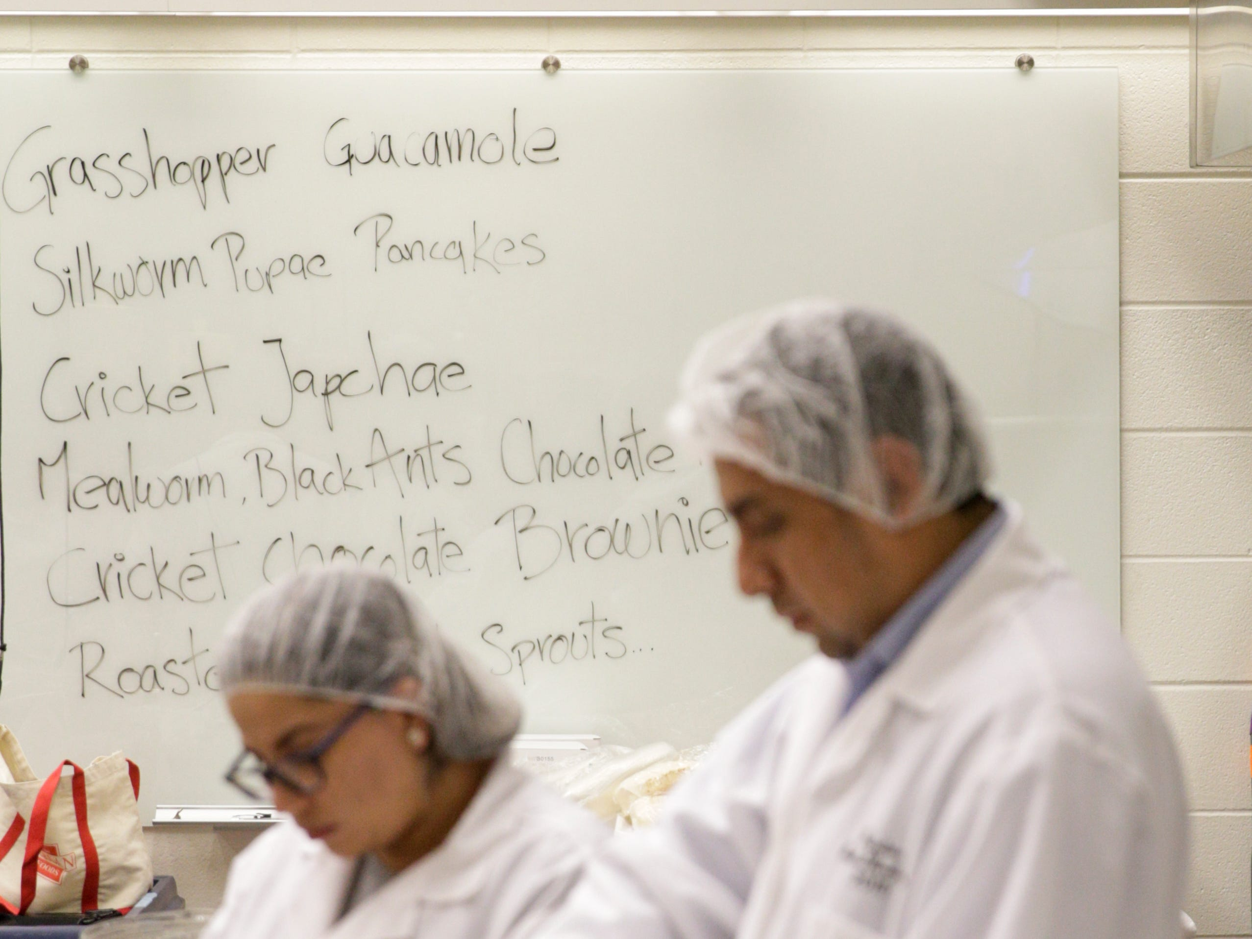 The menu for Spring Fest is written on a whiteboard, Friday, April 5, 2019, at Purdue University in West Lafayette.