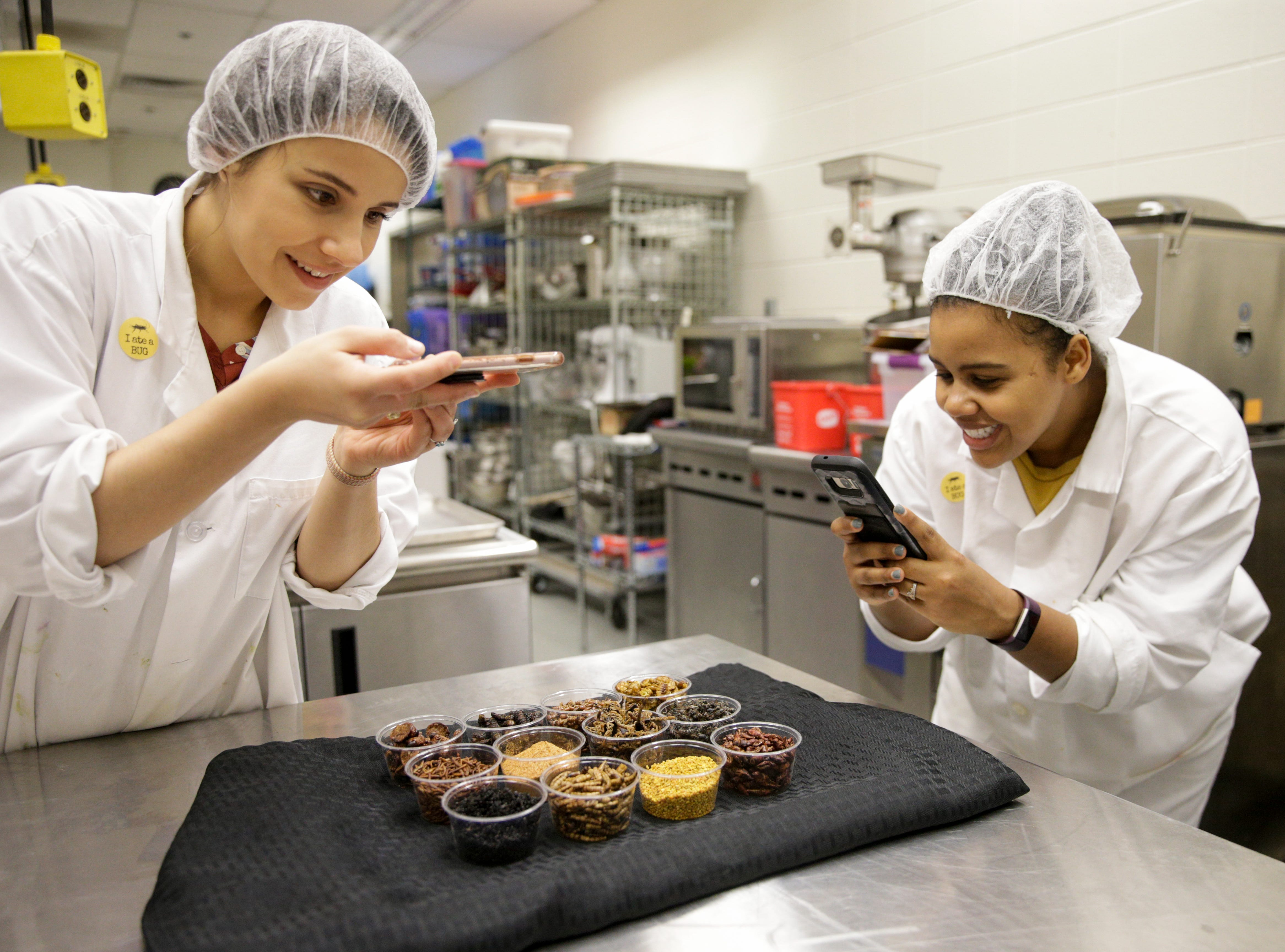 Gabriela Calzada and Felicia Hall take photos of insects they will be cooking with, Friday, April 5, 2019, at Purdue University in West Lafayette. The insects will be incorporated into Joespeh Yoon's dishes and served at Spring Fest on Saturday.