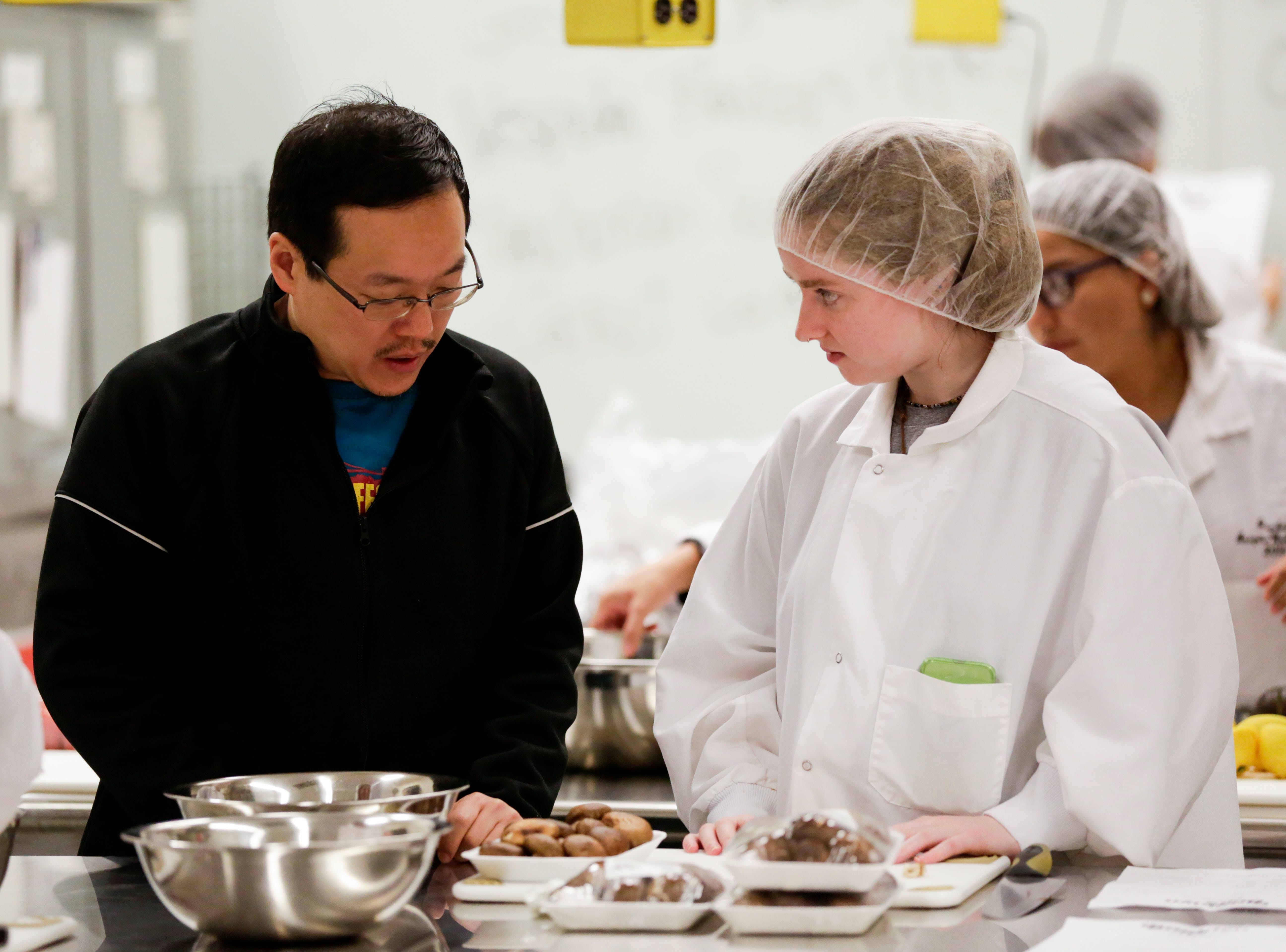 Joseph Yoon, left, of Brooklyn Bugs, talks with Sasha Nerney, a freshman food science student, as they prep dishes for Spring Fest, Friday, April 5, 2019, at Purdue University in West Lafayette. Yoon, the executive director of Brooklyn Bugs, will serve insect incorporated dishes to students during Spring Fest Saturday.