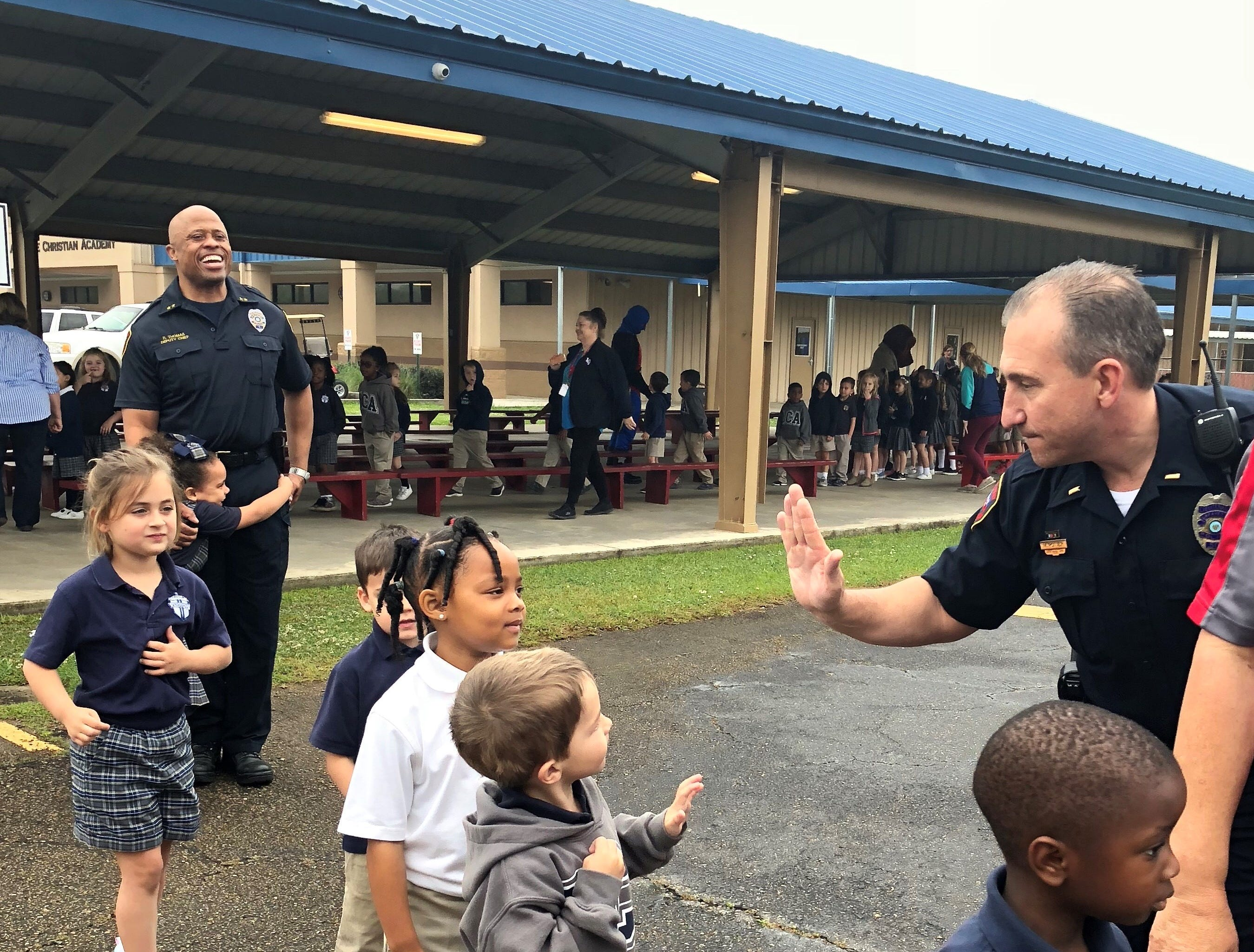 Lafayette Police officers visit with Lafayette Christian Academy students in pre-K, kindergarten and first grade Friday, April 5.