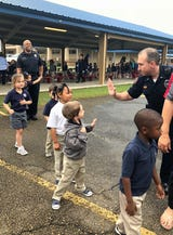 Lafayette Police officers tell Lafayette Christian Academy students what it means to be a police officer.