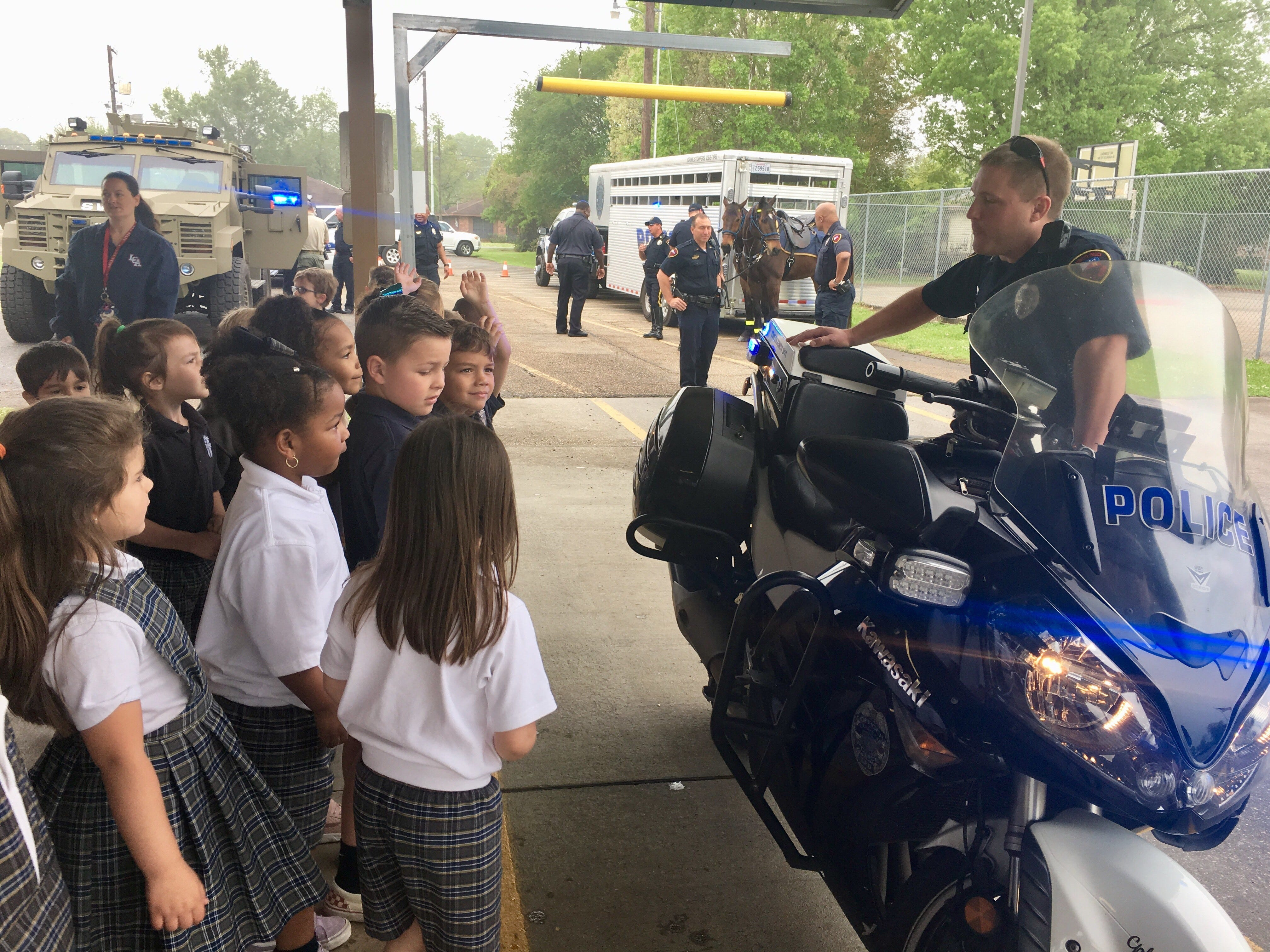 Lafayette Police officers visit with Lafayette Christian Academy students in pre-K, kindergarten and first grade Friday, April 5. Kids check out an officer's motorcycle.