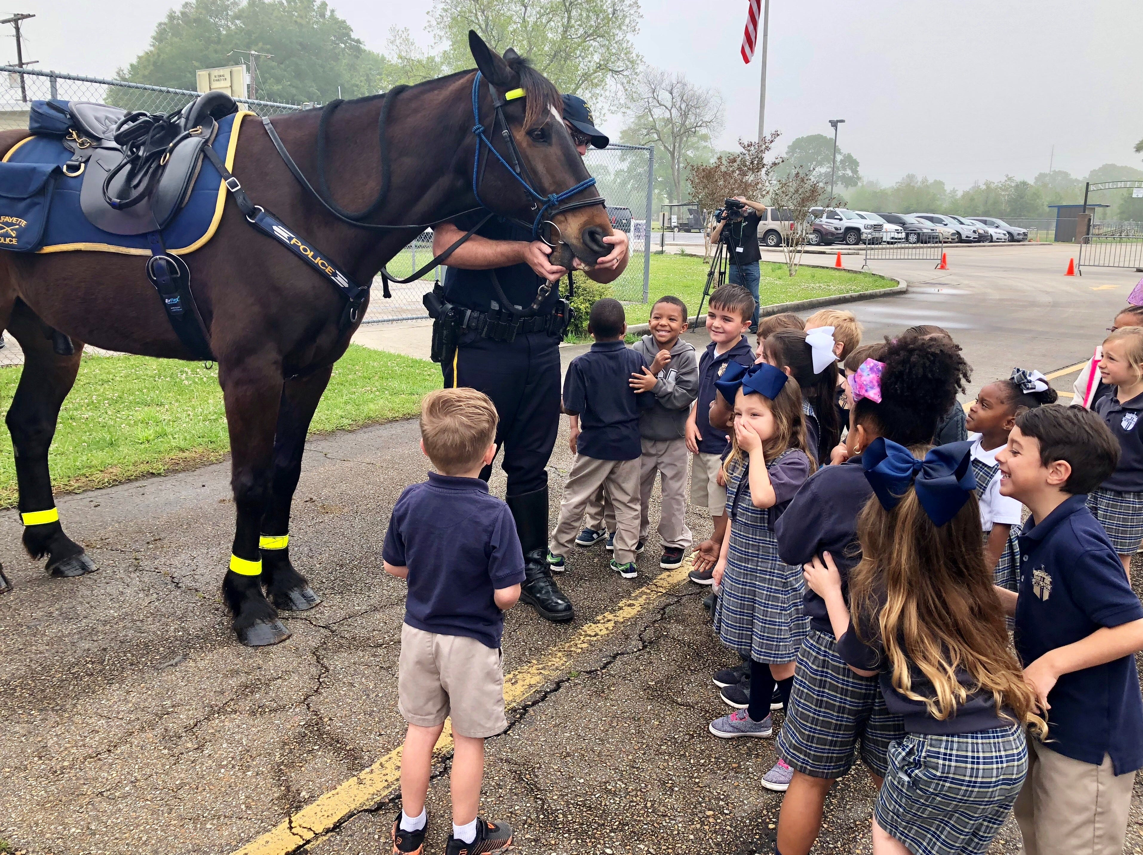 """Lafayette Police officers visit with Lafayette Christian Academy students in pre-K, kindergarten and first grade Friday, April 5. Kids meet the department's """"biggest officers."""""""