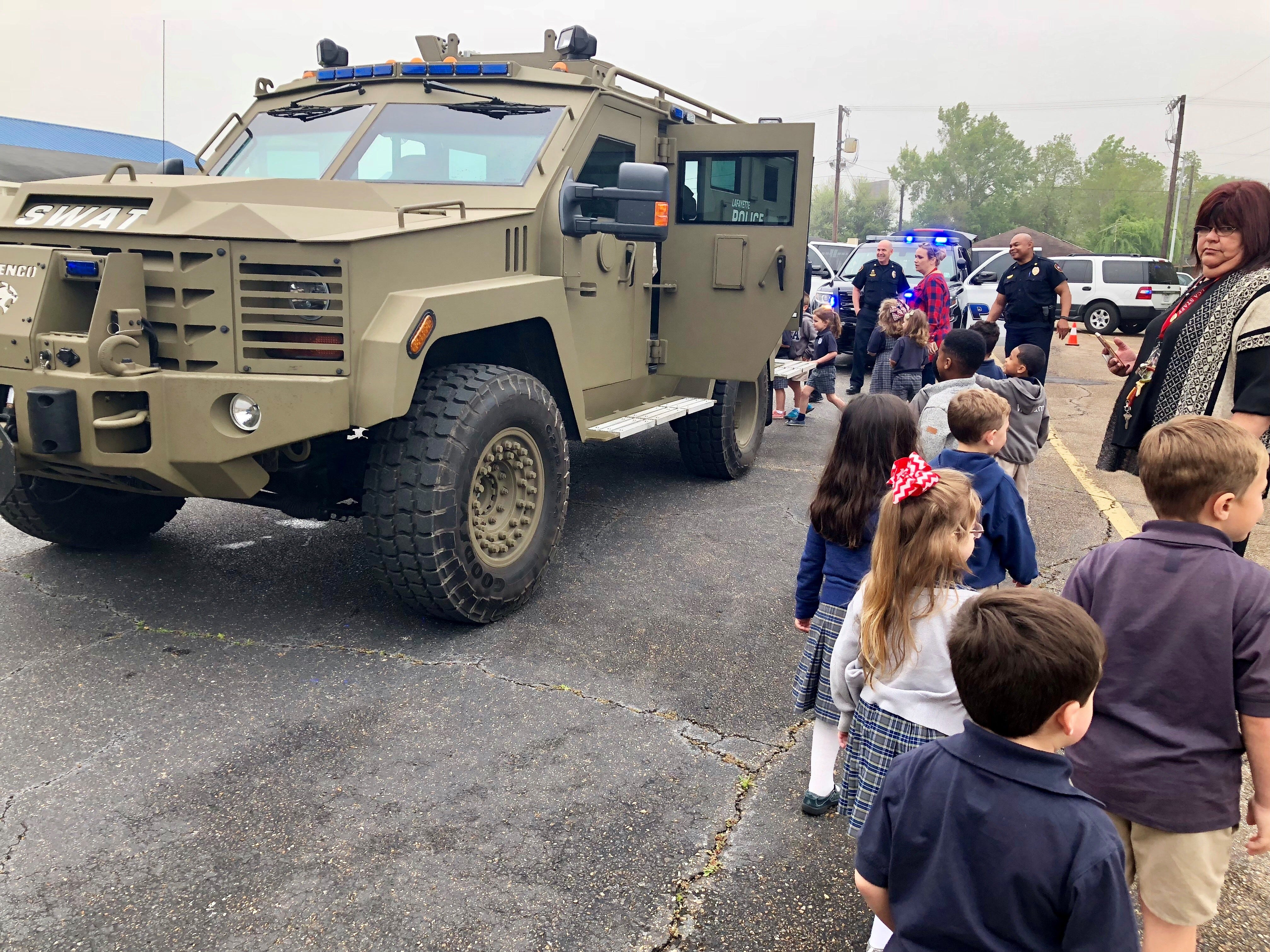 Lafayette Police officers visit with Lafayette Christian Academy students in pre-K, kindergarten and first grade Friday, April 5. Kids check out the SWAT truck.