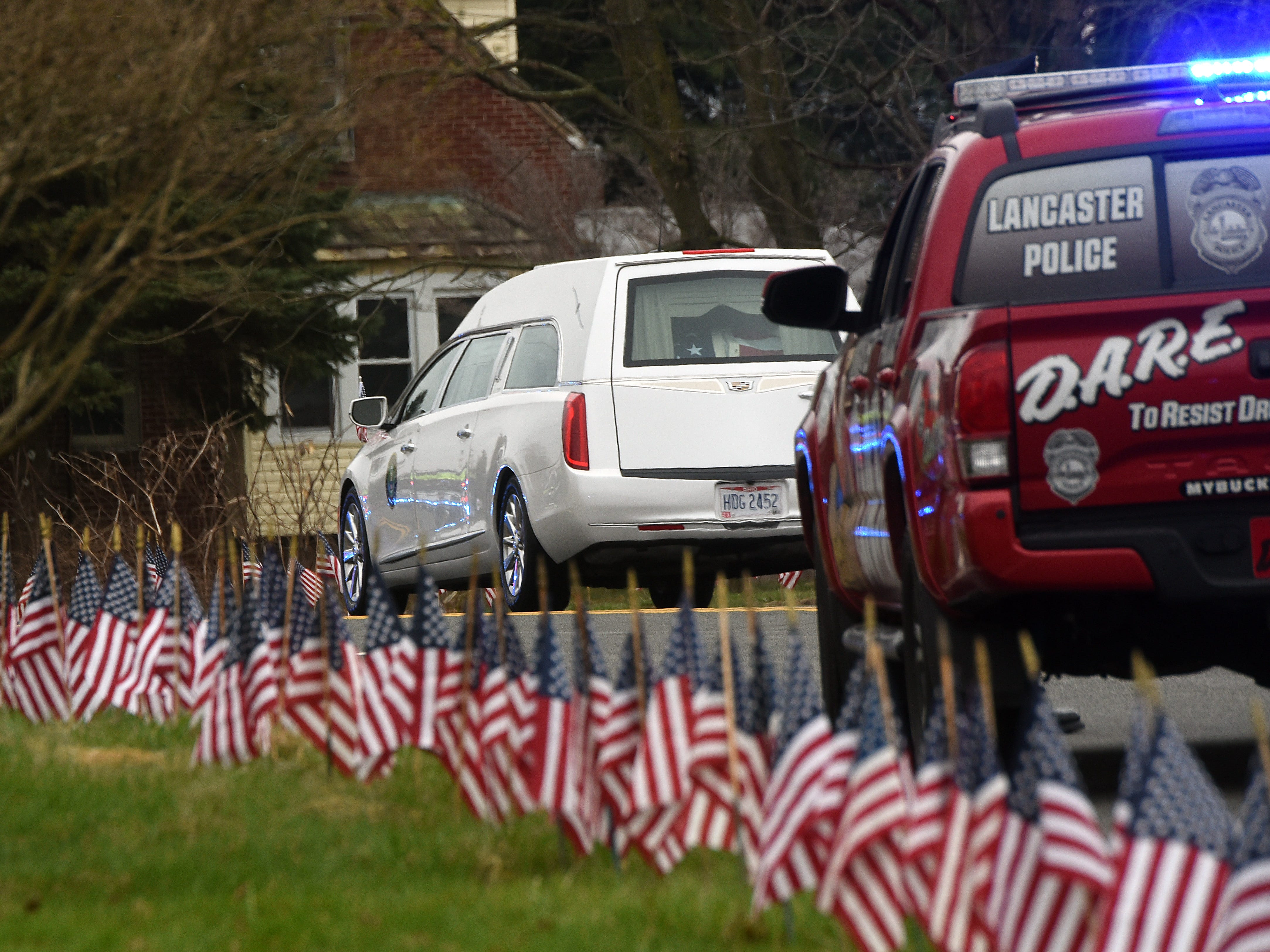The hearse carrying Sgt. Joseph Collette's casket drives down West Fair Avenue after funeral services on Friday, April 5, 2019 at Faith Memorial Church in Lancaster. Collette was killed in action in Afghanistan last month.