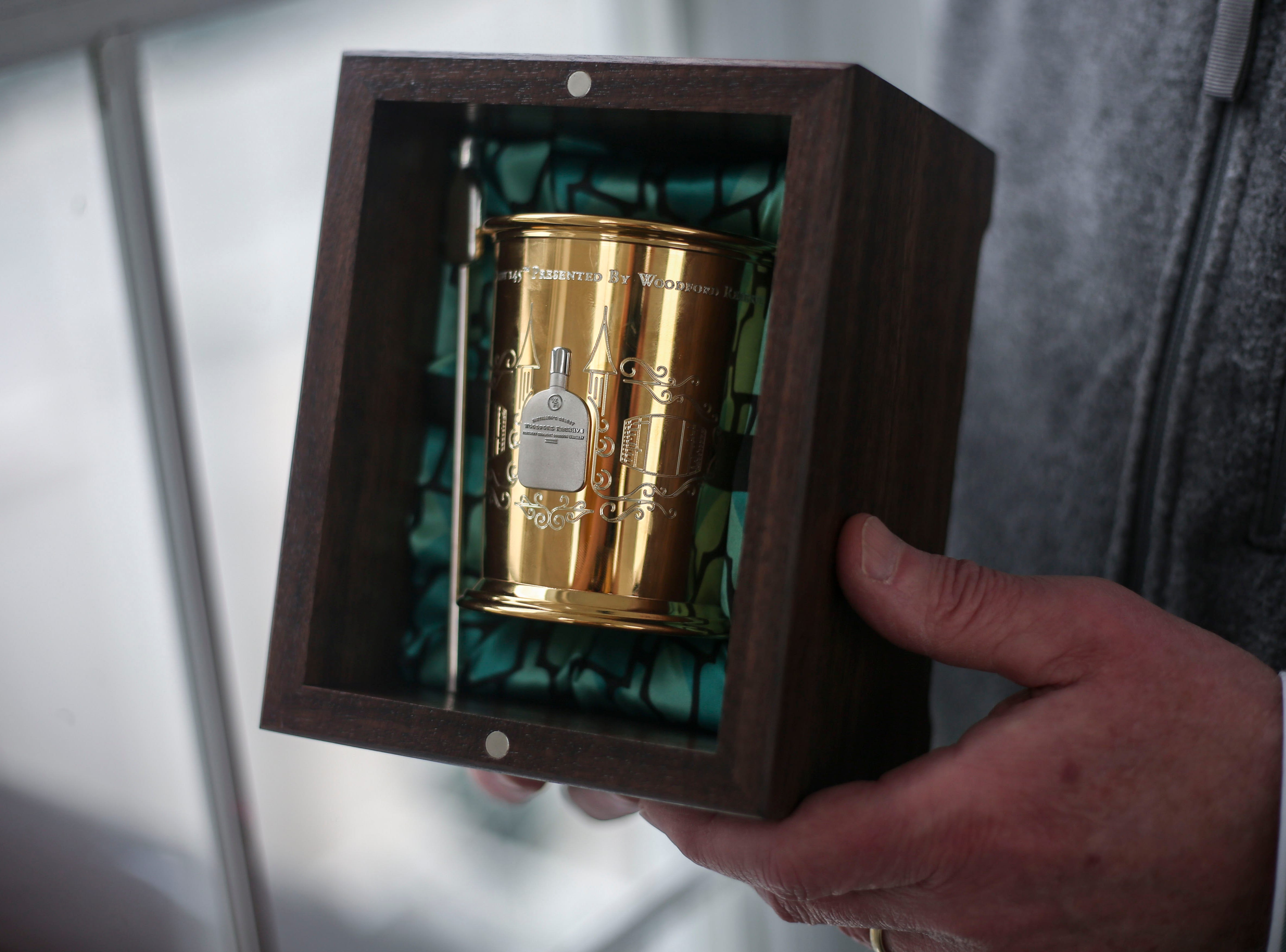 Chris Morris, master distiller at Woodford Reserve, holds this year's 145th Kentucky Derby Woodford Reserve $2,500 mint julep cup, made from 14k gold by From the Vault in St. Matthews, in a box lined with silk from Bourbon Cousins, at Churchill Downs in Louisville, Ky. on Thursday, March 5, 2019.