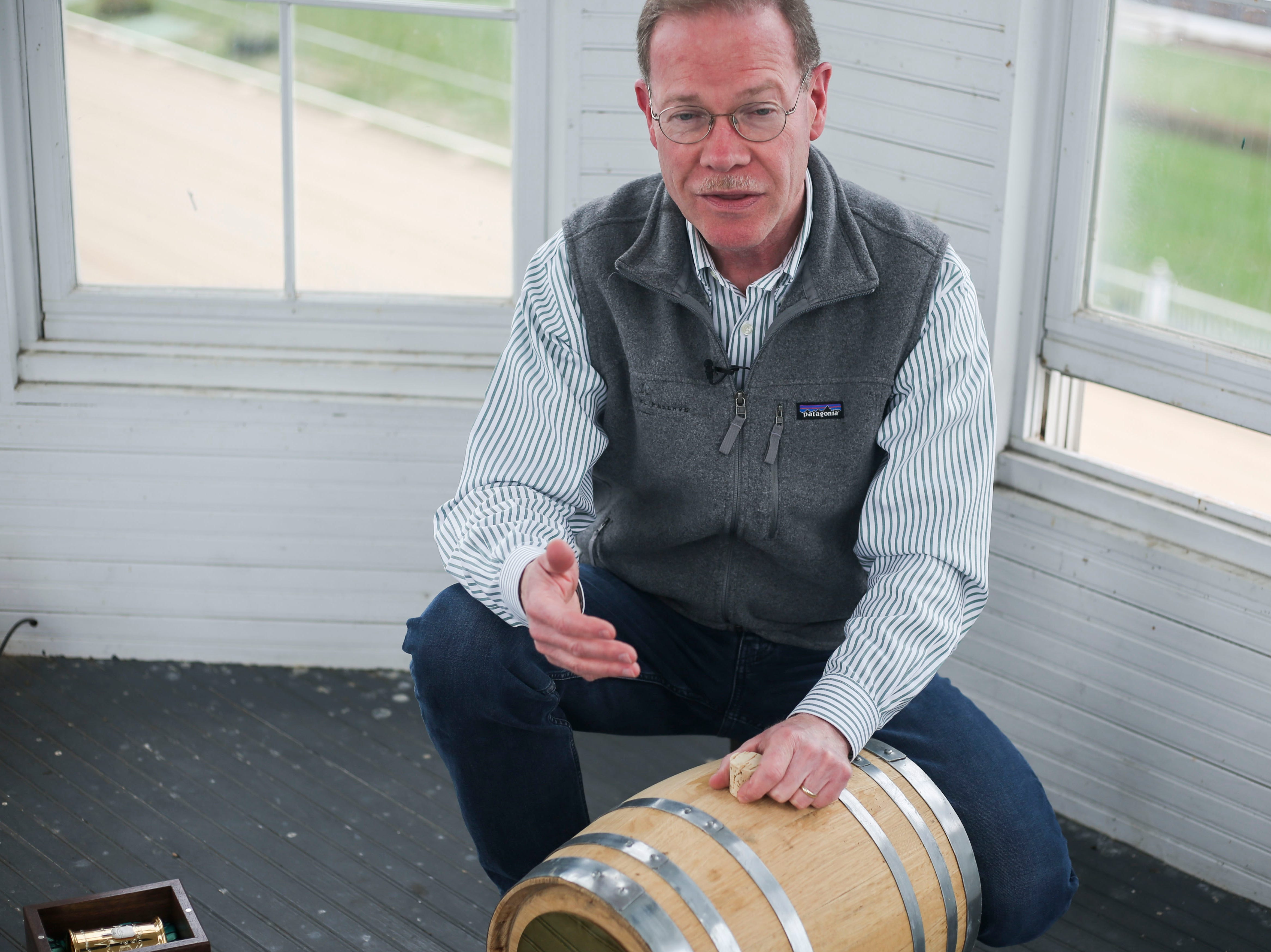 Chris Morris, master distiller at Woodford Reserve, explains the process of aging the simple syrup used in this year's 145th Kentucky Derby Woodford Reserve $1,000 mint julep at Churchill Downs in Louisville, Ky. on Thursday, March 5, 2019. The simple syrup is made from locally sourced limestone water, Hosey Honey (family owned and operated in Midway, Ky.), and mint grown on the Churchill Downs campus, and aged for 145 day in one of the spires in a custom made oak barrel.