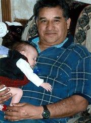 Luis  Gonzalez and one of his grandchildren