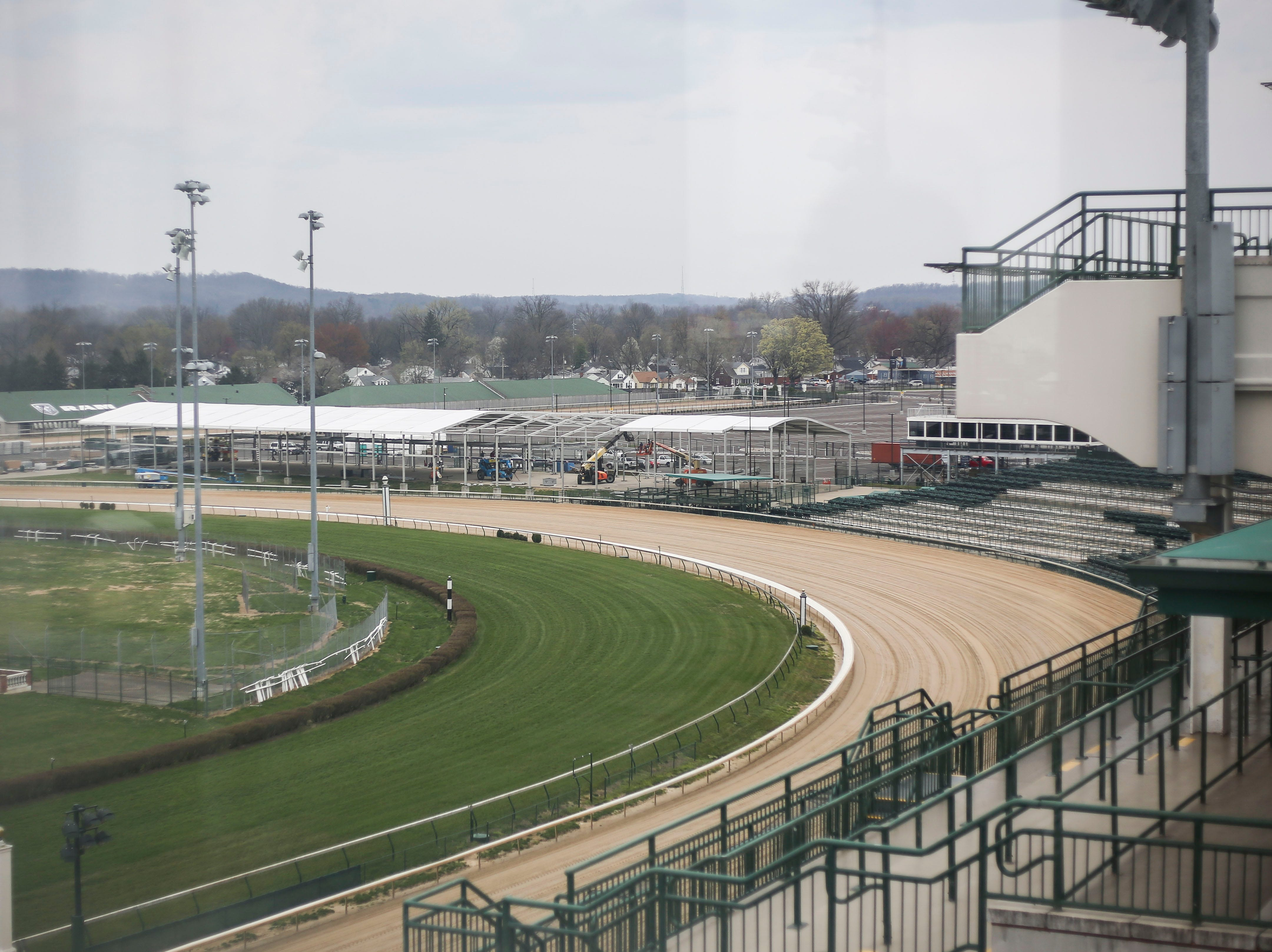 The racetrack can be seen through the window of one of the spires at Churchill Downs where a new charred oak barrel aging simple syrup made from Hosey Honey, locally made in Midland, Ky., limestone water, and mint sprigs grown on the grounds of Churchill Downs, in Louisville, Ky. on Thursday, March 5, 2019.