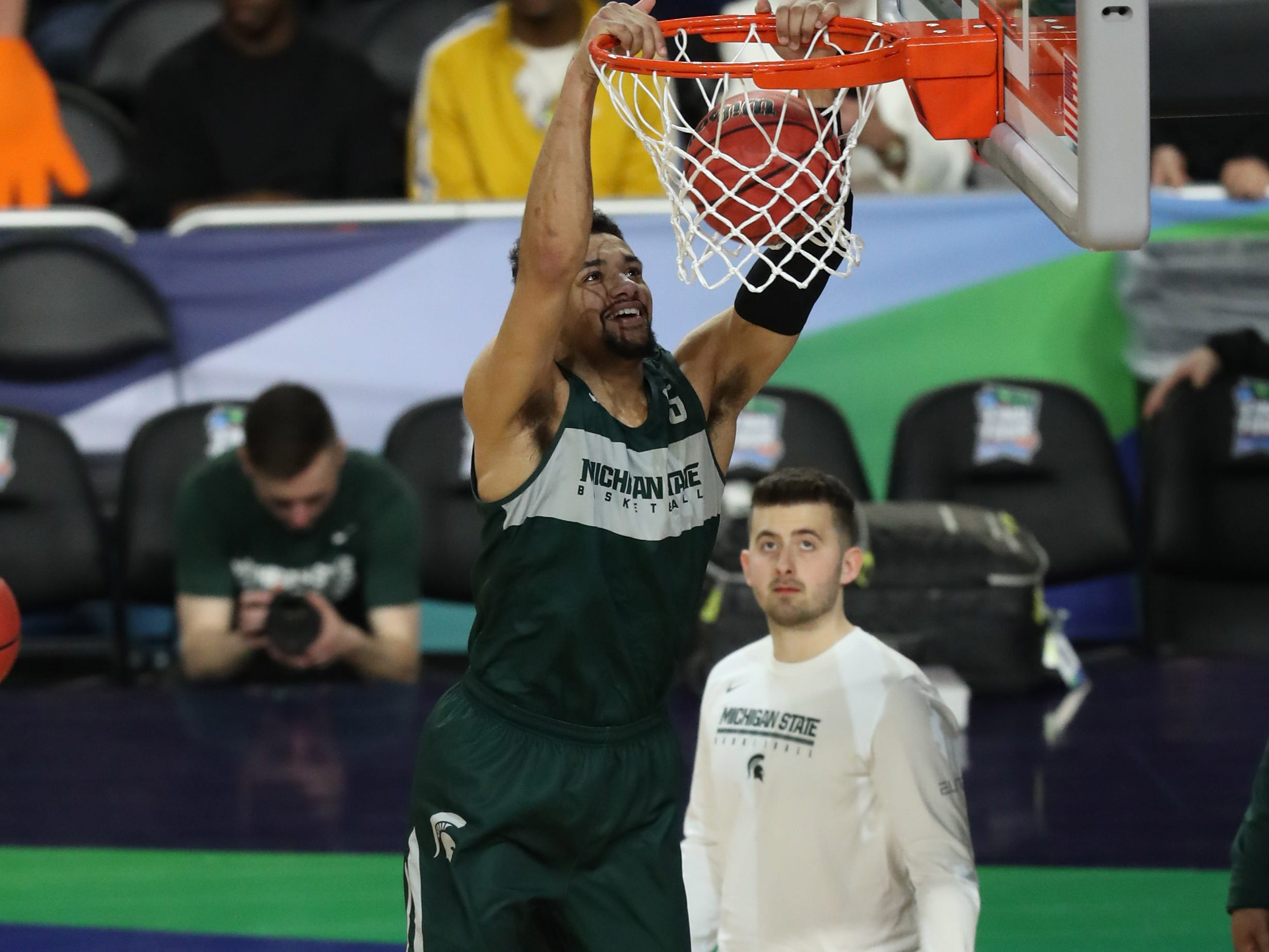 Apr 5, 2019; Minneapolis, MN, USA; Michigan State Spartans guard Cassius Winston (5) dunks the ball during practice for the 2019 men's Final Four at US Bank Stadium. Mandatory Credit: Brace Hemmelgarn-USA TODAY Sports